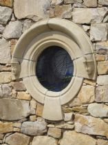 Gothic round hooded window.